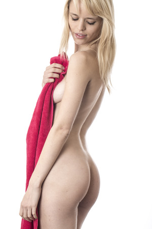 semi nude: Model Released. Naked Young Woman Holding a Towel Stock Photo
