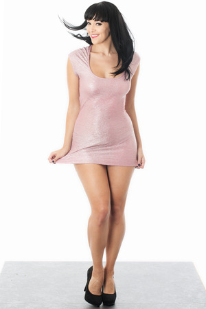 Young Woman Posing in a Short Pink Mini Dress photo