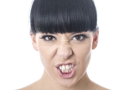 clenching teeth: Angry Young Woman Pulling a Face
