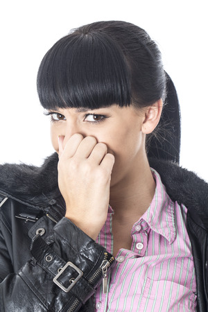 unpleasant: Attractive Young Woman Pinching her Nose Stock Photo