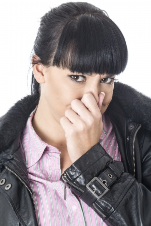 Attractive Young Woman Pinching her Nose photo