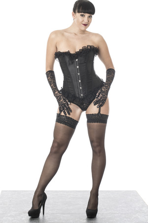 fetish: Fetish Model Posing in Stockings and Corset Stock Photo
