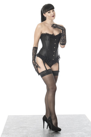Fetish Model Posing in Stockings and Corset photo