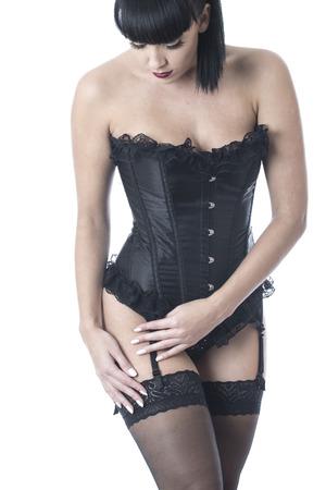 herrin: Fetisch Model posiert in Strümpfe und Korsett Lizenzfreie Bilder