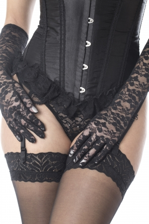Fetish Model Posing in Stockings and Corset Stock Photo