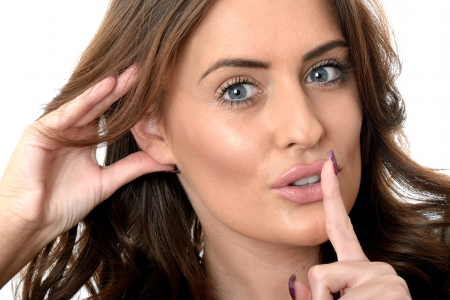 eavesdropping: Attractive Young Woman Eavesdropping Stock Photo