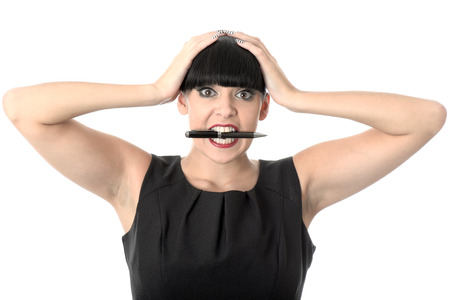 exasperated: Exasperated Young Woman with a Pen in Mouth
