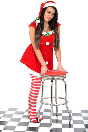 Attractive Young Pin Up Woman in Santa Costume photo