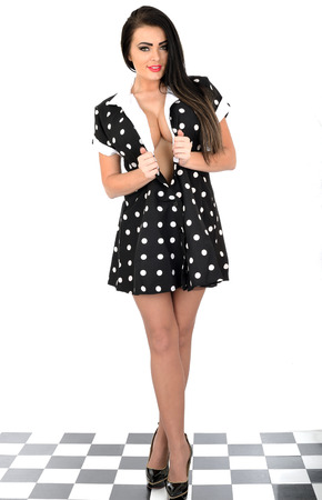 Attractive Young Pin Up Model Sexy Polka Dot Dress photo