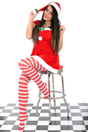 pere noel sexy: Attractive Young Pin Up Woman en costume de P�re No�l Banque d'images