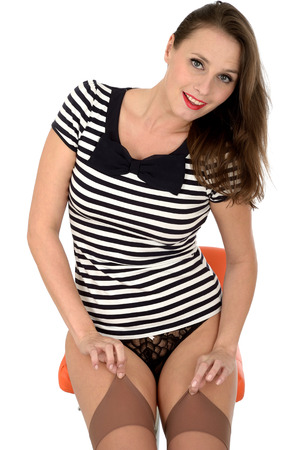 Young Woman Posing in Stockings and Tee Shirt photo