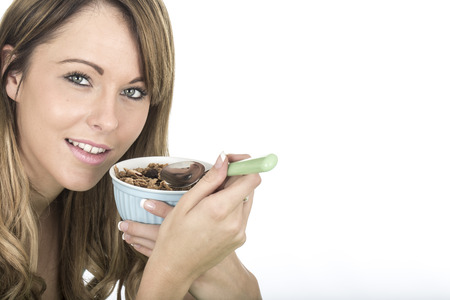 eating breakfast: Attractive Young Woman Eating Breakfast Cereals Stock Photo