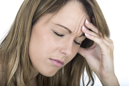 Attractive Young Woman With a Headache Stock Photo