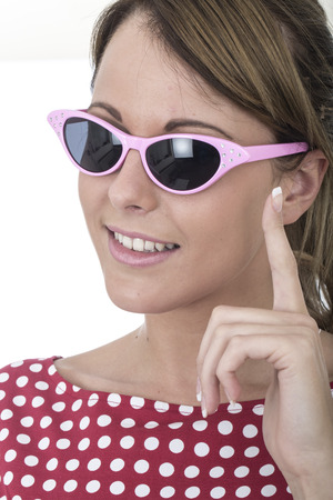 Young Woman Wearing Sun Glasses Holding Up Finger photo