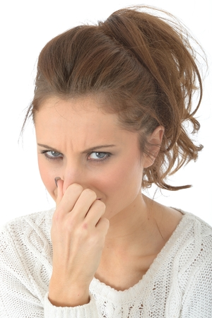 unpleasant: Young Woman Holding Nose Stock Photo