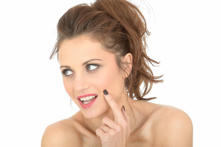 coy: Happy Thoughtful Young Woman Stock Photo
