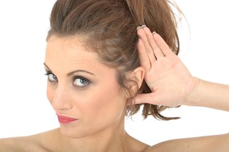 eavesdropping: Young Woman Eavesdropping Stock Photo