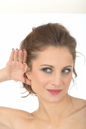 eavesdropping: Young Woman Eavesdropping Stock Photo