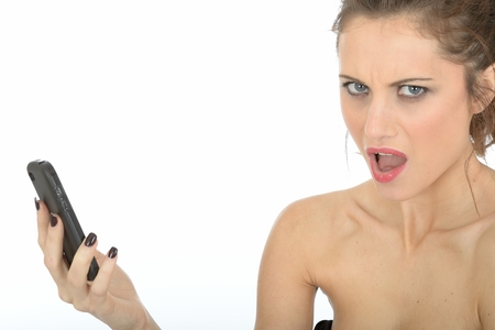 demanding: Young Woman Using Mobile Telephone Stock Photo