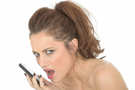 Young Woman Using Mobile Telephone photo