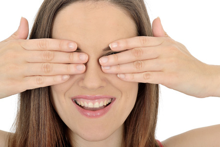 peek a boo: Young Woman Covering her Eyes Stock Photo