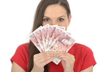 fifty something: Young Woman Holding Money