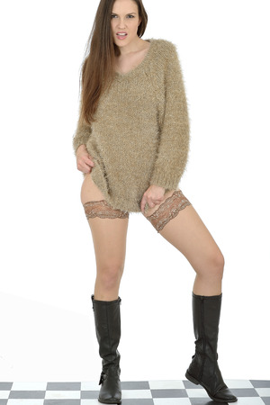 Sexy young Woman Wearing Stockings and a Jumper photo