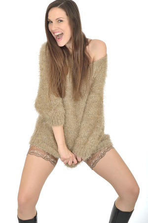 Sexy young Woman Wearing Stockings and a Jumper