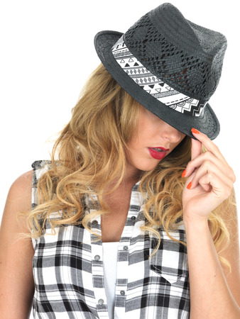 sultry: Sulky Sultry Young Woman Wearing Black Tilbury Hat