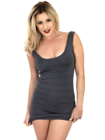 mini dress: Young Woman Wearing Short Cocktail Mini Dress Stock Photo