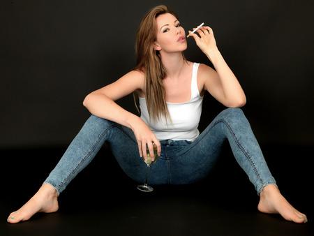 Sexy Sensual Woman Sitting on Floor Smoking photo