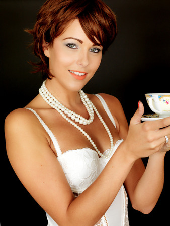 basque woman: Attractive Young Woman Drinking Tea Stock Photo