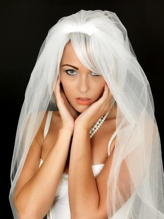 coy: Beautiful Sexy Young Bride Wearing Wedding Veil