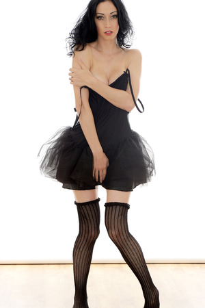 Sexy Young Topless Pin Up Model Wearing a Short Black Dress photo