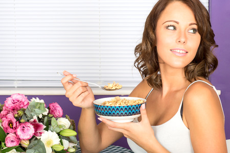 Young Woman Eating Breakfast Cereal photo