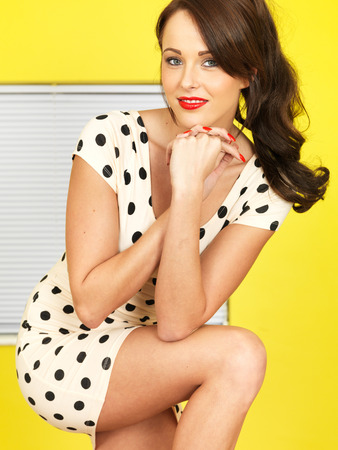 Young Woman Wearing a Short Polka Dot Mini Dress photo