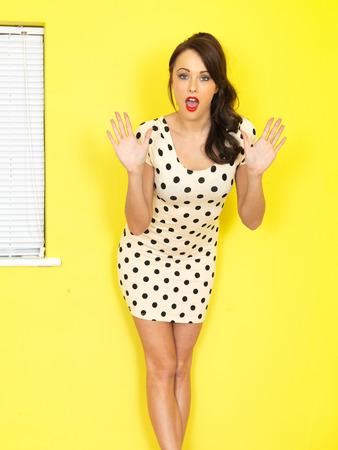 Young Woman Wearing a Short Polka Dot Mini Dress