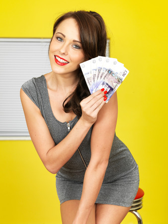 Attractive Happy Young Woman Holding Money