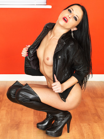 nude model: Sensual Sexy Nude model in Black Leather Jacket and Knee Boots