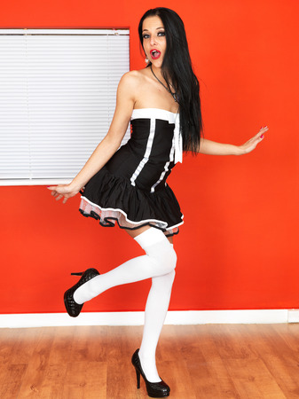Sexy Young Woman in a Short French Maids Outfit photo