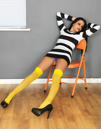 chic panties: Attractive Sexy Young Woman Wearing a Mini Dress and Yellow Stockings