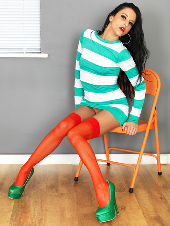 Young Sexy Woman Wearing a Mini Dress Stockings and High Heels Stock Photo