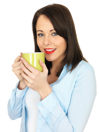 Attractive Twenty Something Young Woman Drinking Coffee photo
