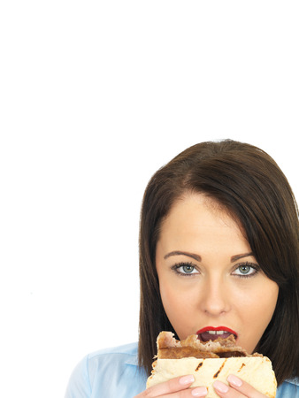 donner: Attractive Young Twenty Something Woman Eating Donner Kebab Stock Photo