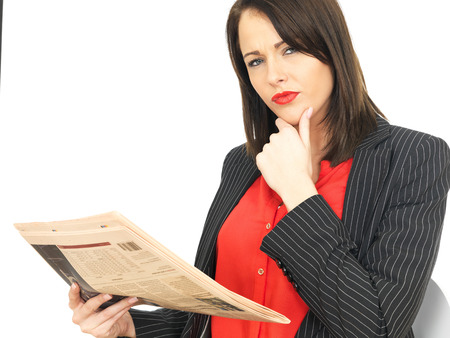 abreast: Attractive Business Woman Reading a Newspaper