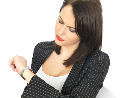 cut wrist: Attractive Business Woman Checking the Time on Her Watch