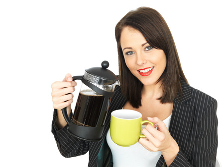 elevenses: Attractive Business Woman Pouring Coffee