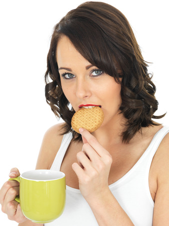 elevenses: Young Woman With Tea and Biscuit