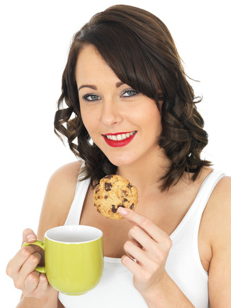 elevenses: Attractive Young Woman With Tea and Biscuits