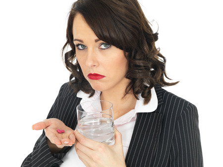 getting better: Unwell Business Woman Taking Tablets Stock Photo